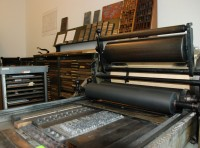 PRINTING PRESS & ADVERTISEMENT